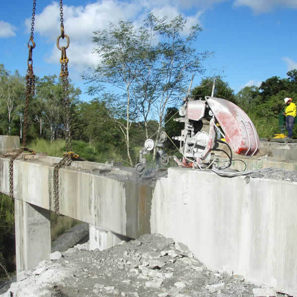Bridge headstocks being cut with wire saw for removal